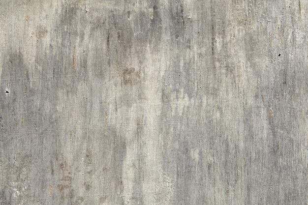 Поверхность состаренного листа фанеры, поцарапанная и потрескавшаяся, текстура для.