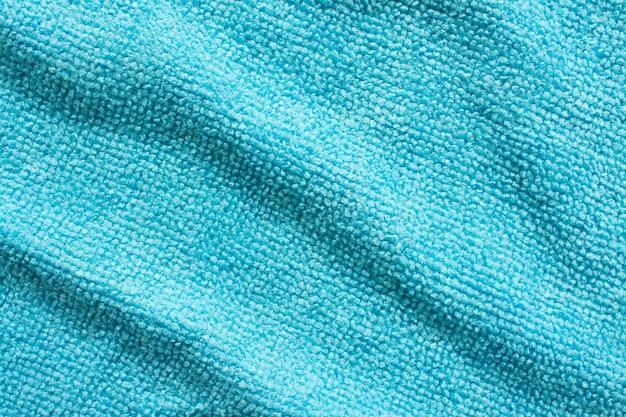 Поверхность синей ткани из микрофибры, макро текстильный узор фона