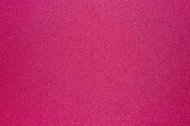 鮮やかなマゼンタ色の布の表面