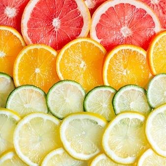 柑橘系の果物のレモン、オレンジ、ライム、グレープフルーツの表面。