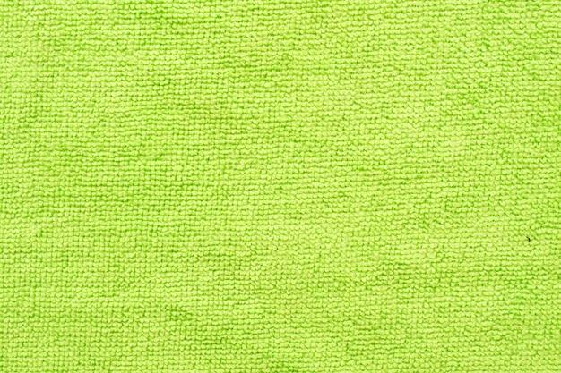緑のマイクロファイバーの布、マクロ繊維パターン背景の表面