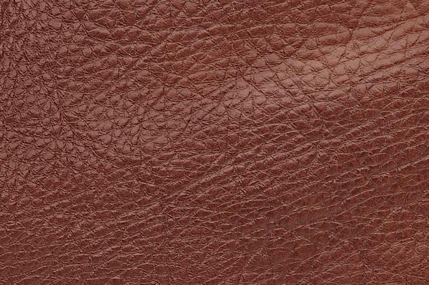 茶色の光沢のある革の表面