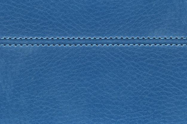 あなたの仕事のデザインの背景のための革の青い袋の背景の表面。