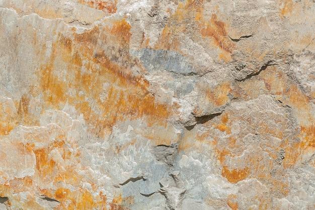 茶色の色合い、石のテクスチャ、背景を持つ大理石の表面。