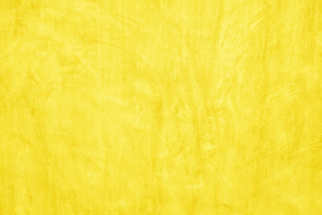 Surface pattern of beautiful yellow cement texture background