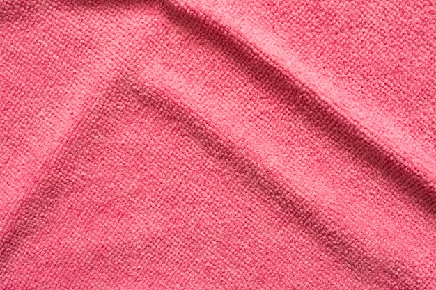 Surface of pink microfiber cloth, macro textile pattern background