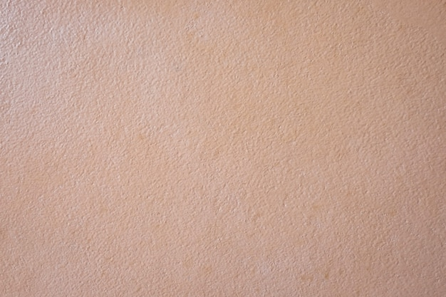 Surface of smooth orange cement wall texture background for design in your work concept backdrop.