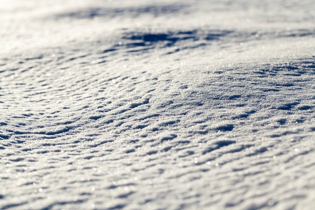 The surface of the snow in the winter season. the photo was taken close-up from the side, shallow depth of field.