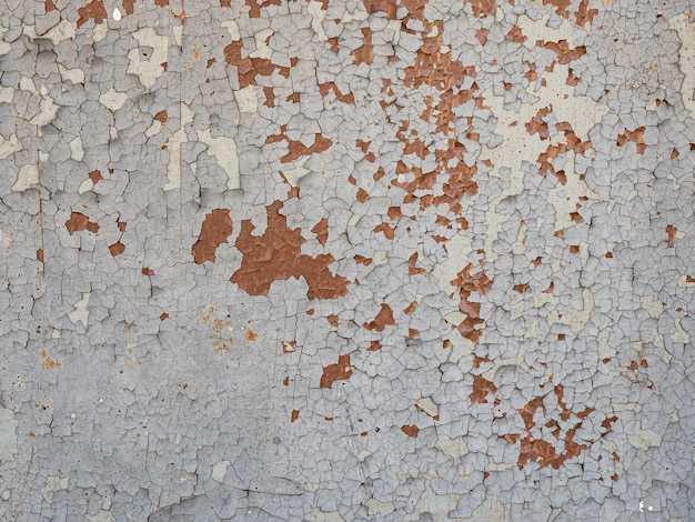 Surface texture of old painted iron wall with peeling paint.