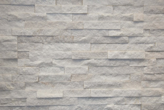 Поверхность белая стена каменная стена серых тонов для использования в качестве фона. мозаика из камня.