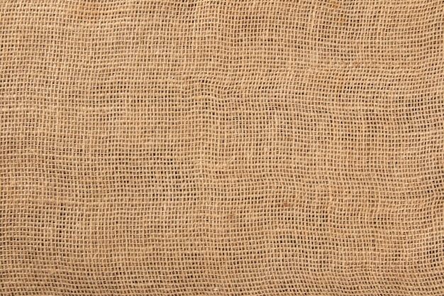 Surface with texture of jute fabric close up.