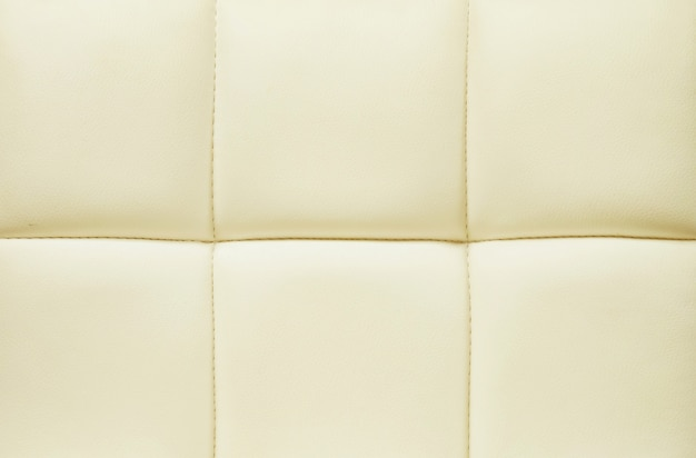 Surface of yellow leather of sofa texture background