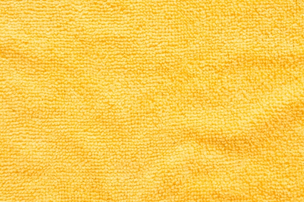 Surface of yellow microfiber cloth, macro textile pattern background