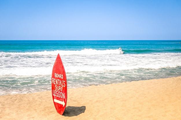 Surfboard at exclusive beach - surfing school destinations worldwide