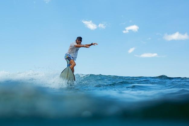 Surfer on a blue wave.