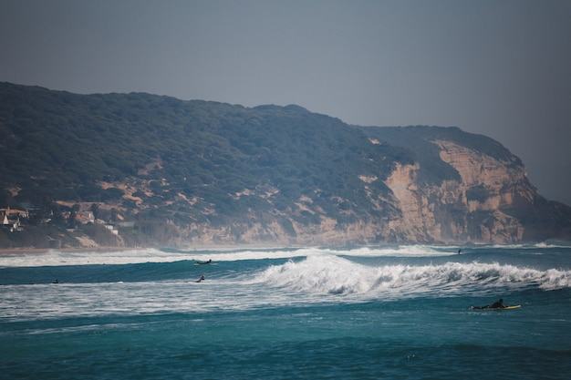 Surfers on the sea with waves