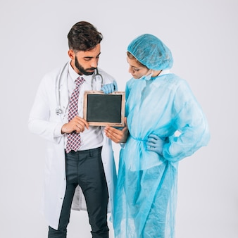 Surgeon and doctor holding and watching the blackboard
