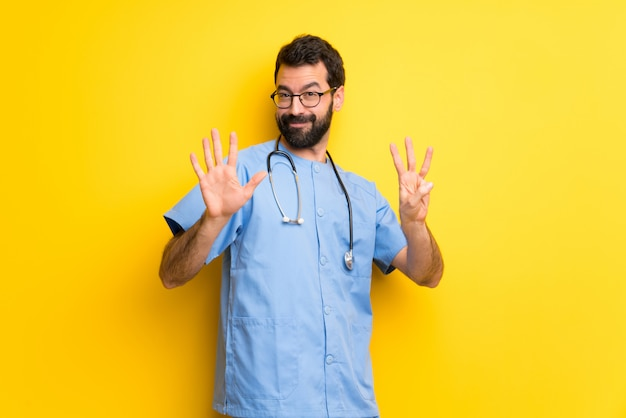 Surgeon doctor man counting eight with fingers