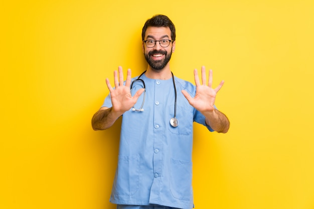 Surgeon doctor man counting ten with fingers