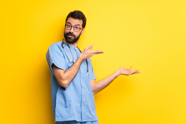 Surgeon doctor man extending hands to the side for inviting to come