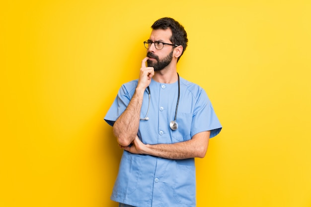 Surgeon doctor man having doubts while looking up
