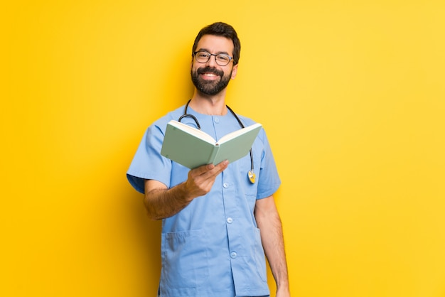Surgeon doctor man holding a book and giving it to someone