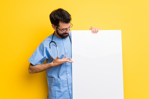 Surgeon doctor man holding a placard for insert a concept