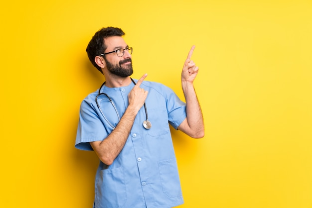 Surgeon doctor man pointing with the index finger and looking up
