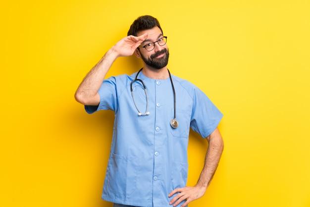 Surgeon doctor man saluting with hand