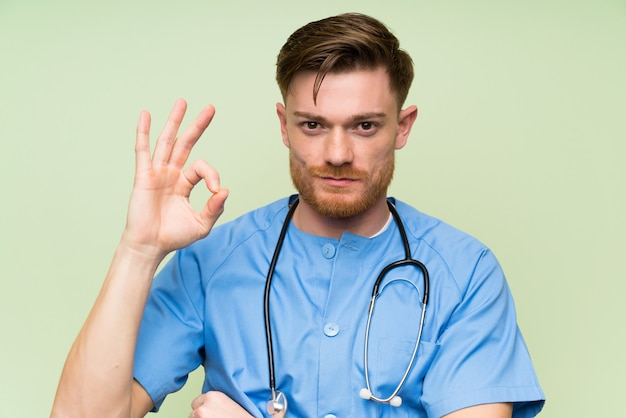 Surgeon doctor man showing an ok sign with fingers