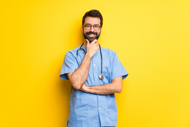 Surgeon doctor man with glasses and smiling