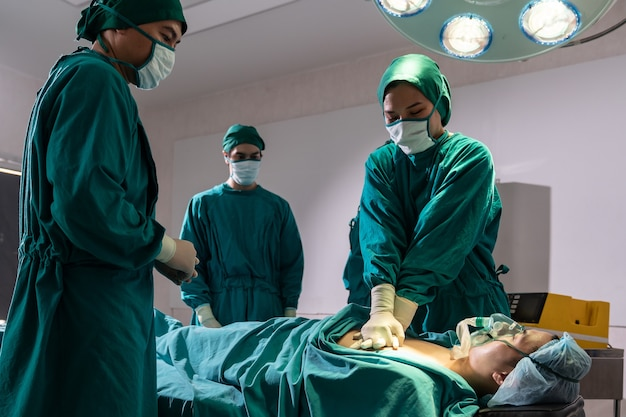 Surgeon doctor and nurse do cpr to patient