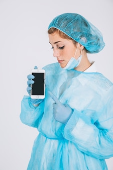 Surgeon posing with the phone's screen