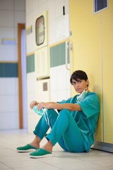Surgeon sitting on the floor
