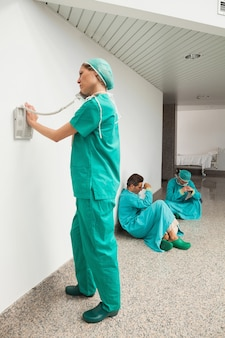Surgeon using the phone