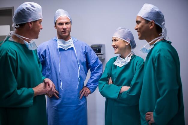 Surgeons having discussion in corridor