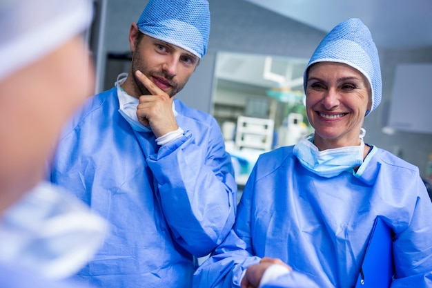 Surgeons interacting with each other in operation room