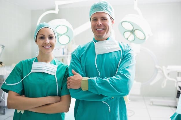 Surgeons looking at camera
