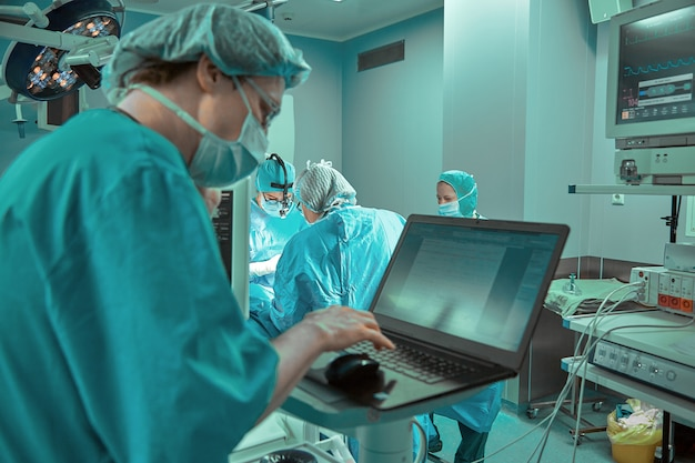 Surgeons team in the operating room, portraits close-up. modern operating, plastic surgery. beauty industry
