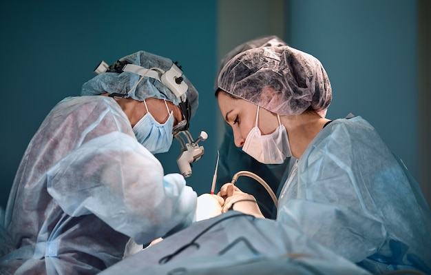 Surgeons team in the operating room portraits close-up modern operating plastic surgery beauty industry