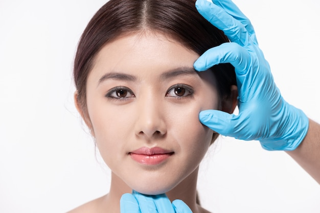 Surgery concept. asian beautiful woman doing facial surgery.