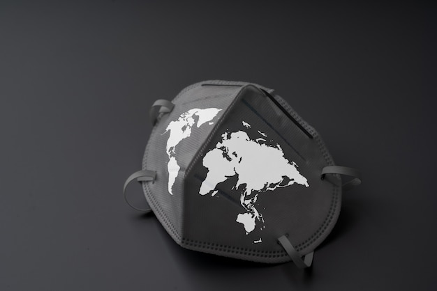 The surgery mask with world map icon for epidemic concept & covid 19 virus