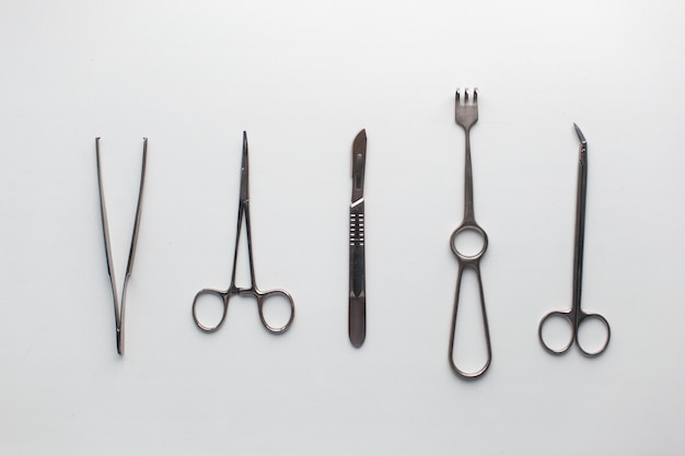 Surgical instruments on a white table.