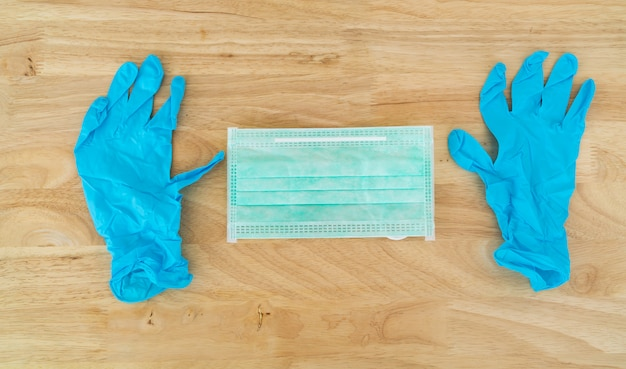 Surgical mask and medical gloves.
