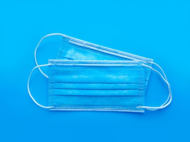 口と鼻を覆うサージカルマスクまたは医療用マスク、ウイルス、インフルエンザ、コロナウイルス、感染症からの保護。