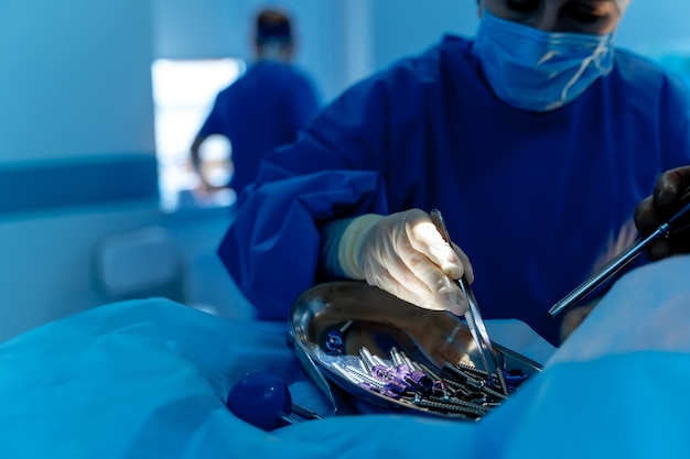 Surgical room in hospital with robotic technology equipment, machine arm surgeon in futuristic operation room. minimal invasive surgical innovation, medical robot surgery with endoscopy
