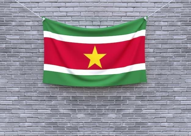 Suriname flag hanging on brick wall
