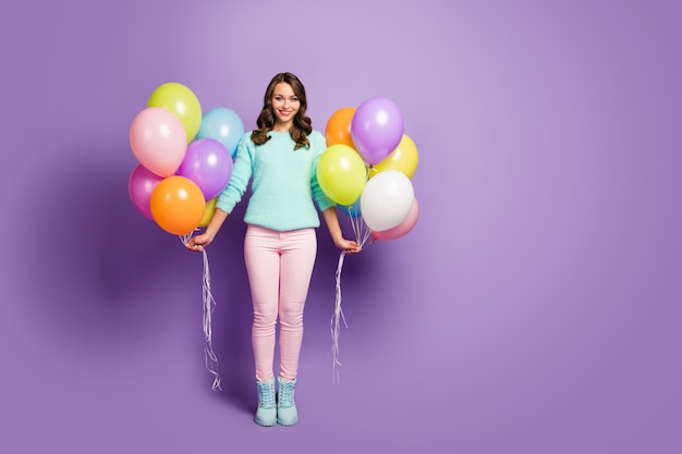 Surprise! full size portrait of pretty lady bring many colorful air balloons friends event party wear fuzzy mint sweater pink pastel pants boots.