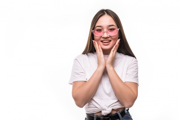 Surprised asian woman in sunglasses isolated on white wall
