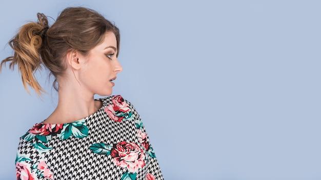 Surprised attractive lady in elegant dress